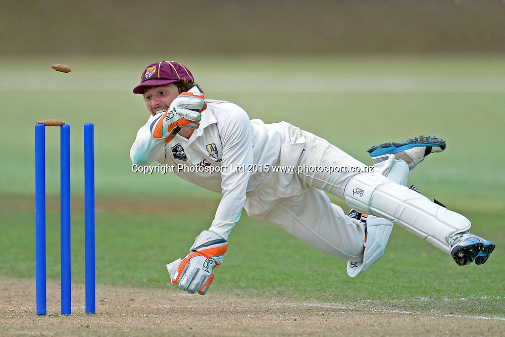 Northern Districts keeper BJ Watling attempts a runout at the last  ball of the day. Plunket Shield. 4 Day match between Auckland and Northern Districts at Colin Maiden Park in Auckland. New Zealand. Sunday 08 February 2015. Copyright Photo: Raghavan Venugopal/www.photosport.co.nz