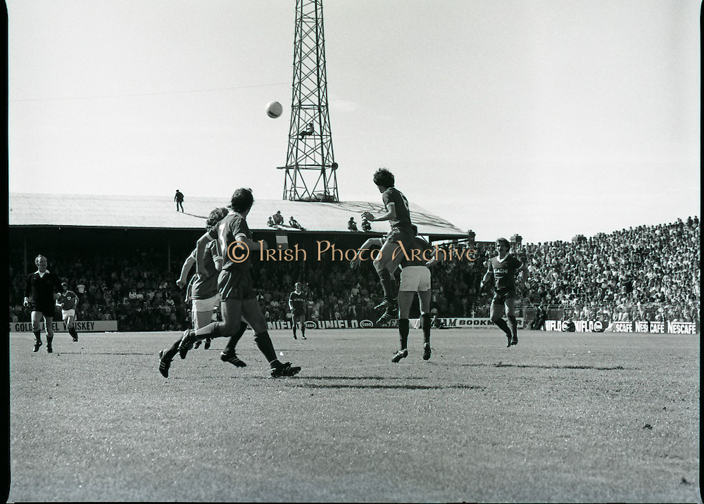 League of Ireland vs Liverpool FC.    (M87)..1979..18.08.1979..08.18.1979..18th August !979..In a pre season friendly the League of Ireland took on Liverpool FC at Dalymount Park Phibsborough,Dublin. The league team was made up of a selection of players from several League of Ireland clubs and was captained by the legendary John Giles. Liverpool won the game by 2 goals to nil..The scorers were Hansen and McDermott...Picture shows that fans could find the best vantage points, note the fan up in the floodlight tower.