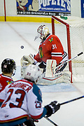 KELOWNA, CANADA - APRIL 08:  Kelowna Rockets right wing Reid Gardiner #23, Portland Winterhawks goalie Cole Kehler #31 at the Kelowna Rockets game on April 08, 2017 at Prospera Place in Kelowna, British Columbia, Canada.  (Photo By Cindy Rogers/Nyasa Photography,  *** Local Caption ***