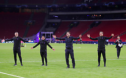Tottenham Hotspur manager Mauricio Pochettino (second right) and staff celebrate on the pitch after the final whistle