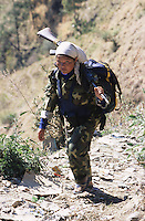Kusapani, 03 March 2005... A Maoist fighter arriving in a small village of Surket District.