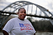Sherry Mitchell, 46, a community worker advocating for a community-wide fight against poverty,  guns restrictions for people under 21. She is standing in front of the Selma bridge.<br /> <br /> In March 1965 a Civil Rights march was held, led by Rev. Martin Luther King, from Selma Alabama to the state capital of Montgomery to demand the right to vote. Systematic local police violence against the marchers, forced US president Johnson to send in federal troops to protect the demonstrators right to march and eventually vote.