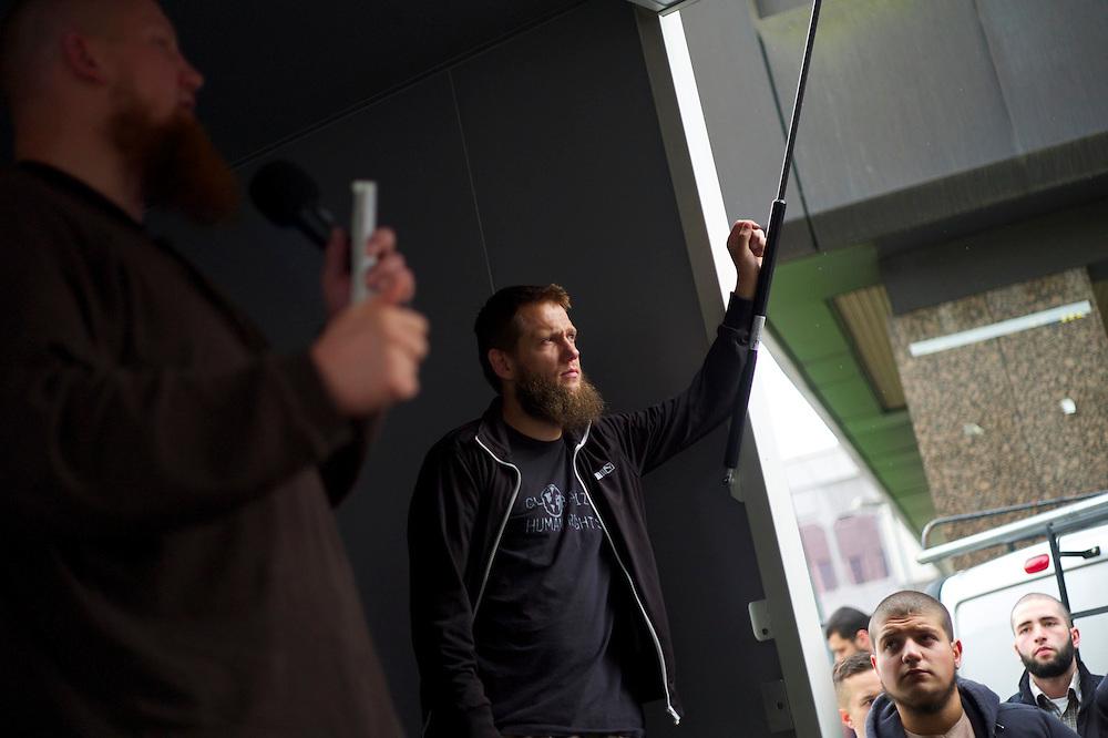 Offenbach | Germany | 28.06.2014: Der salafistische, slebsternannte Hassprediger Pierre Vogel (Abu Hamsa) spricht in Offenbach vor 200 Anh&auml;ngern unter dem Protest von mehreren Hundert B&uuml;rgern aus allen Bev&ouml;lkerungsgruppen, die Vogels Positionen ablehnen.<br /> <br /> hier: Sven Lau (Abu Adam) (rechts) predigte zum Thema &quot;Unterdr&uuml;ckung der Frau im Islam&quot;, links Pierre Vogel<br /> <br /> <br /> Sascha Rheker<br /> 20130628<br /> NUTZUNG HONORARPFLICHTIG<br /> [Inhaltsveraendernde Manipulation des Fotos nur nach ausdruecklicher Genehmigung des Fotografen. Vereinbarungen ueber Abtretung von Persoenlichkeitsrechten/Model Release der abgebildeten Person/Personen liegt/liegen nicht vor.] [No Model Release | No Property Release]