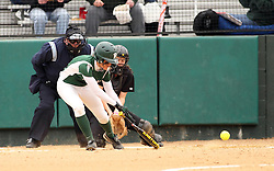 30 March 2013:  Audra James during an NCAA Division III women's softball game between the DePauw Tigers and the Illinois Wesleyan Titans in Bloomington IL<br />