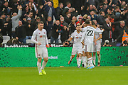 Sheffield United forward Lys Mousset (22) celebrates with teammates after scoring a goal (1-0) during the Premier League match between West Ham United and Sheffield United at the London Stadium, London, England on 26 October 2019.