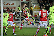 Stephen Kelly (Rotherham United) heads the ball across the penalty box from the corner during the Sky Bet Championship match between Rotherham United and Huddersfield Town at the New York Stadium, Rotherham, England on 19 April 2016. Photo by Mark P Doherty.