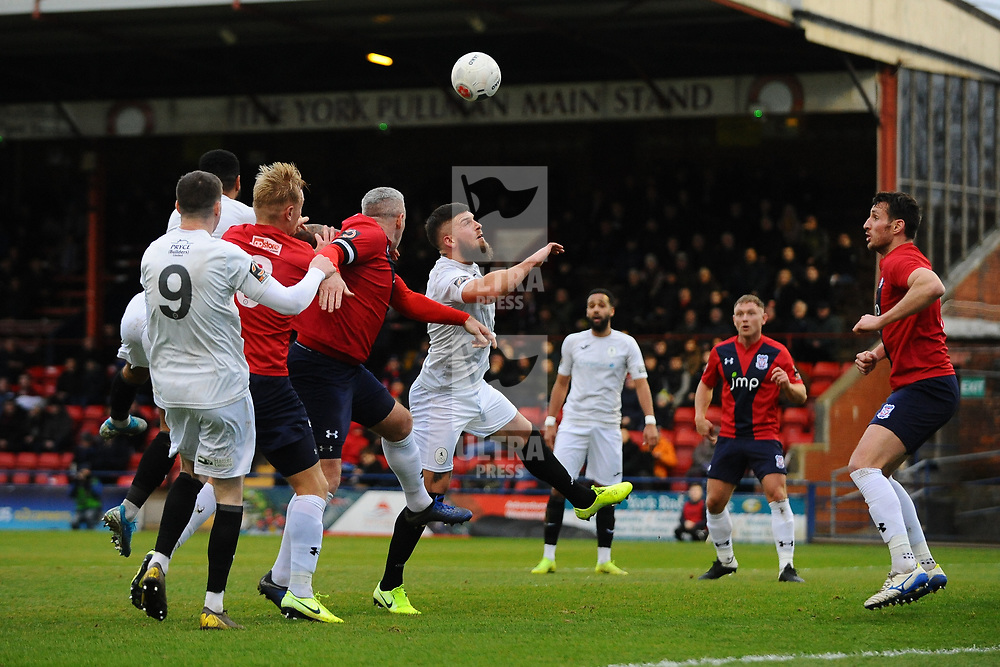 TELFORD COPYRIGHT MIKE SHERIDAN Shane Sutton of Telford battles for a header in the penalty area during the Vanarama Conference North fixture between AFC Telford United and York City at Bootham Crescent on Saturday, January 11, 2020.<br /> <br /> Picture credit: Mike Sheridan/Ultrapress<br /> <br /> MS201920-040