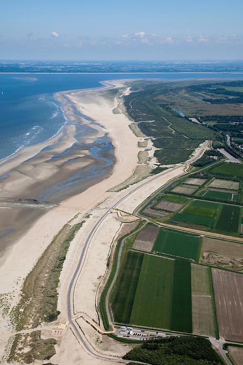 Nederland, Zuid-Holland, Ouddorp, 12-06-2009; Het Flaauwe Werk aan de kust van Goeree, een van de Zwakke Schakels van de kust, gezien naar het eiland Voorne-Putten. De zeewering bestaat hier uit een zeedijk, de met asfalt beklede dijk is versterkt en verhoogd en van een nieuwe laag zand voorzien..Swart collectie, luchtfoto (25 procent toeslag); Swart Collection, aerial photo (additional fee required); .foto Siebe Swart / photo Siebe Swart