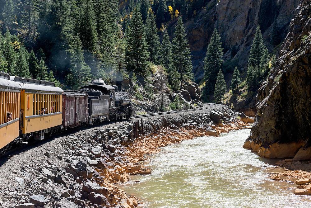 Durango & Silverton Narrow Gauge Railroad steam train in the Animas River Canyon in Southwest Colorado.