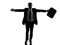 one caucasian business man running happy arms outstretched in silhouette on white background