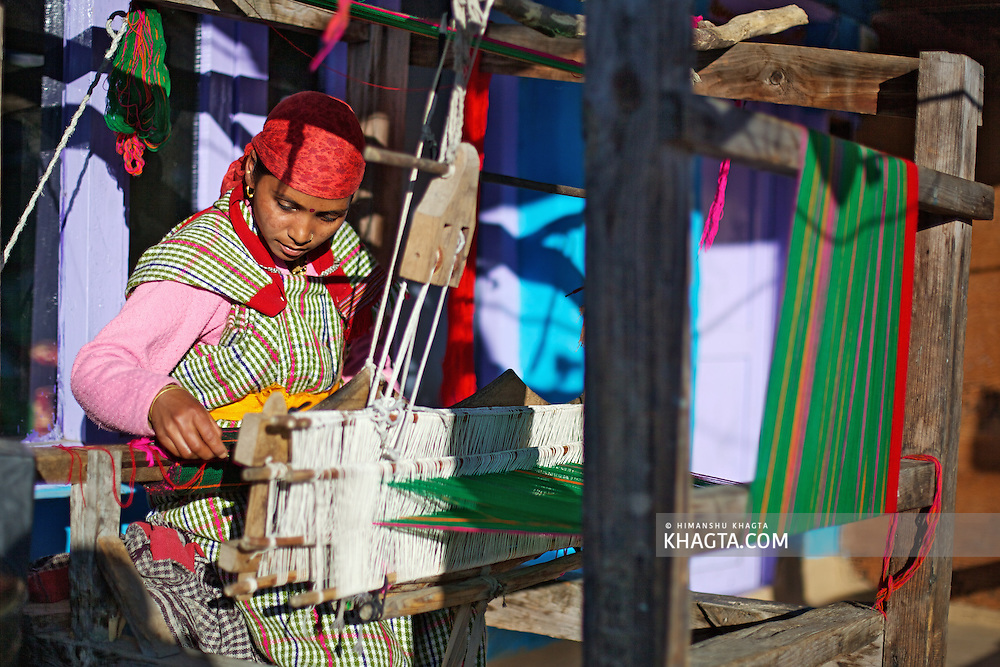 A weaver of Kullu making the famous Kullu Shawl in the backyard of her home.