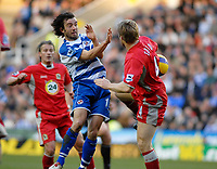Photo: Gareth Davies.<br />Reading v Blackburn Rovers. The Barclays Premiership. 16/12/2006.<br />Reading's Steven Hunt (C) and Blackburn's Andy Todd (R) challenge for the ball.