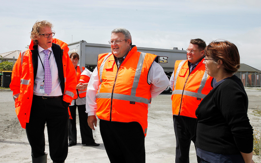 Roger Sutton, CEO CERA, left and Gerry Brownlee, Earthquake Recovery Minister, centre, speaking to a local  in the first of 11  Red Zone properties purchased by Canterbury Earthquake Recovery Authority to be demolished, CERA, begins in Bexley, Christchurch, New Zealand, Monday, January 30, 2012.  Credit:SNPA / Pam Johnson