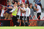 Brentford defender John Egan (14)  celebrating scoring 2-0 with team mates during the EFL Sky Bet Championship match between Brentford and Ipswich Town at Griffin Park, London, England on 13 August 2016. Photo by Matthew Redman.