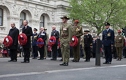 The Anzac Day tradition -WW1 memorial. New Zealand High Commissioner to the UK Sir Alexander Lockwood Smith, right, and Australian High Commissioner to the UK Mike Rann hold wreaths with Australian servicemen in a service of remembrance at The Cenotaph, Whitehall, London, United Kingdom. Friday, 25th April 2014. Picture by Daniel Leal-Olivas / i-Images