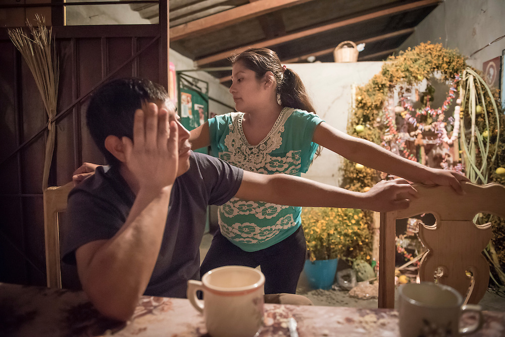 As Santiago Garcia's two-week break from work quickly elapses, taking care of the children by herself in Santa Ana weighs into Garcia Pacheco's mind. Nick Wagner / Alexia Foundation