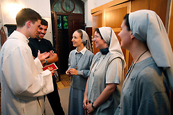 A catholic priest and  sisters at back of church. (Photo by Vid Ponikvar / Sportal Images)