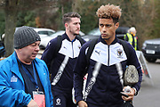 AFC Wimbledon striker Lyle Taylor (33) and AFC Wimbledon goalkeeper Joe McDonnell (24) arriving during the EFL Sky Bet League 1 match between AFC Wimbledon and Southend United at the Cherry Red Records Stadium, Kingston, England on 1 January 2018. Photo by Matthew Redman.