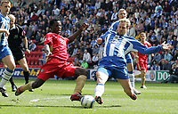 Photo: Paul Thomas.<br /> Wigan Athletic v Portsmouth. The Barclays Premiership. 29/04/2006.<br /> <br /> Portsmouth's Benjani Mwaruwari shot at goal is blocked by Stephane Henchoz.
