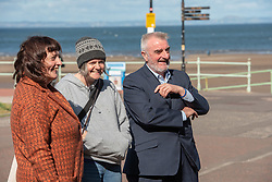 Art Walk Porty founder and producer Rosy Naylor shows local MP Tommy Sheppard around some of the work and meets some of the artists in this year's Art Walk in Portobello. Pictured:<br /> Artist Rhona Taylor discussing her work with Rosy Naylor and Tommy Sheppard MP © Jon Davey/ EEm