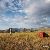 hiker camping in burnt creek lwc, with burnt creek wsa, taylor mountain lwc and the lost river range background