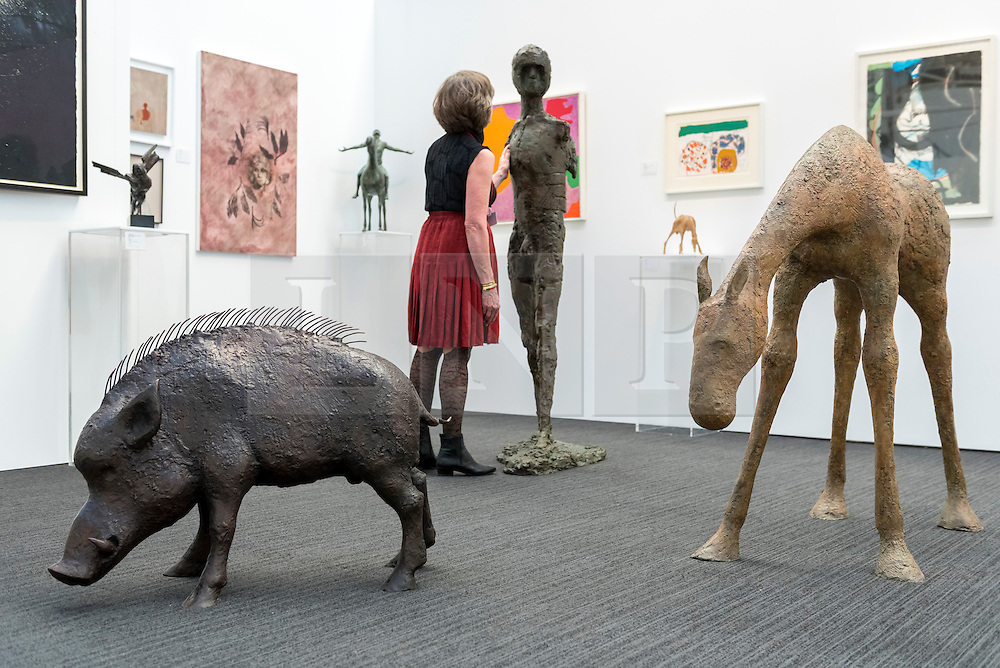 """© Licensed to London News Pictures. 17/01/2017. London, UK. Sculptures (L to R) """"Cian"""" by Anthony Scott (GBP 16,000), """"Birdman"""" by Elisabeth Frink (GBP 450,000) and """"Etain III"""" by Anthony Scott (GBP35,000), at the preview of the 29th London Art Fair, the UK's premier fair for Modern British and contemporary art, taking place at the Business Design Centre in Islington from 18-22 January 2017, where 129 galleries from 18 different countries will be presenting their artworks. Photo credit : Stephen Chung/LNP"""