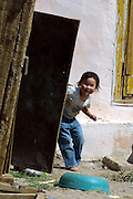 GOBI DESERT, MONGOLIA..08/31/2001.Young girl at Bayangovi..(Photo by Heimo Aga).