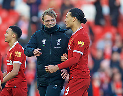 LIVERPOOL, ENGLAND - Saturday, February 24, 2018: Liverpool's manager Jürgen Klopp celebrates the 4-1 victory over West Ham United with Virgil van Dijk after the FA Premier League match between Liverpool FC and West Ham United FC at Anfield. (Pic by David Rawcliffe/Propaganda)