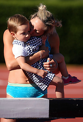 Alenka Bikar kisses her daughter Pia at Athletic National Championship of Slovenia, on July 19, 2008, in Stadium Poljane, Maribor, Slovenia. (Photo by Vid Ponikvar / Sportal Images).