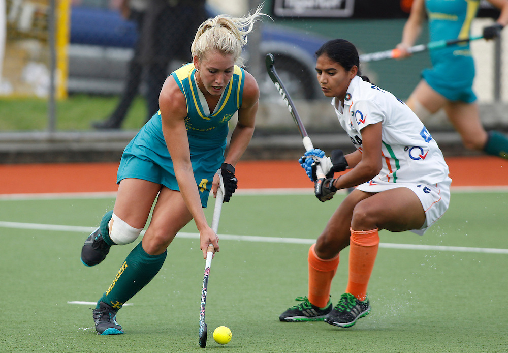 Australia's Casey Eastham pushes past India's Poonam Rani during their four nations hockey match at North Harbour Hockey Stadium, Auckland, New Zealand, Sunday, April 15, 2012. Credit:SNPA / Ben Campbell..