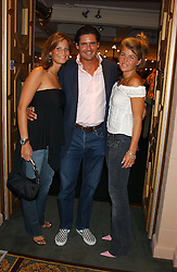 Left to right, JULIA BAUMHOFF, EDWARD TAYLOR and AMBER NUTTAL at a party to celebrate 'Made in Italy at Harrods' - a celebration of Italian fashion food and wine, design and interiors, art and photography, cinema and music, beauty and glamour.  The party was held in the Georgian Restaurant at Harrods, Knightsbridge, London on 9th September 2004.<br />