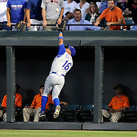 09 August 2008:  Texas Rangers right fielder Jason Ellison (16) makes a running catch on a ball hit by Baltimore Orioles catcher Ramon Hernandez to end the 3rd inning at Camden Yards in Baltimore, MD.  The Orioles defeated the Rangers 9-0.  ****For Editorial Use Only****