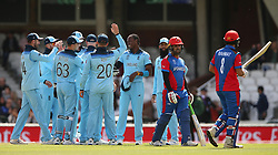 England's Jofra Archer (fourth right) celebrates after taking the wicket of Afghanistan's Rahmat Shah (right) during the ICC Cricket World Cup Warm up match at The Oval, London.