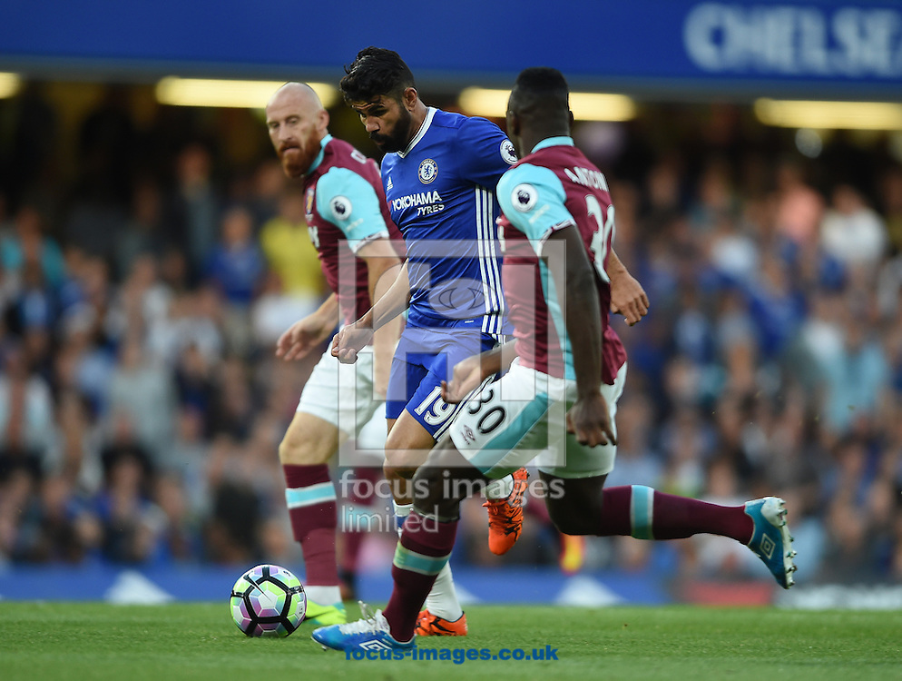 Chelsea's Diego Costa bursts past James Collins (left) and Michail Antonio (right) of West Ham United during the Premier League match at Stamford Bridge, London<br /> Picture by Daniel Hambury/Focus Images Ltd +44 7813 022858<br /> 15/08/2016