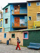 "In La Boca barrio (neighborhood) of Buenos Aires, tourists are attracted by colorful houses, the Caminito pedestrian street, La Ribera theatre, tango clubs, and Italian taverns. La Boca retains a strong European flavor, with many early settlers from Genoa, Italy. It sits at the mouth (""boca"" in Spanish) of the Matanza River (or Río Mataderos, or Riachuelo which simply means ?Creek?). La Boca is known among sports fans for La Bombonera stadium (Estadio Alberto J. Armando), home of Boca Juniors, one of the world's best known football (soccer) clubs. As a centre for radical politics, La Boca elected the first socialist member of the Argentine Congress (Alfredo Palacios in 1935) and hosted many demonstrations during the crisis of 2001 in Argentina, South America."