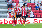 Chris Maguire (#7) of Sunderland AFC celebrates with Charlie Wyke (#9) after scoring the second goal for Sunderland during the EFL Sky Bet League 1 match between Sunderland and AFC Wimbledon at the Stadium Of Light, Sunderland, England on 24 August 2019.