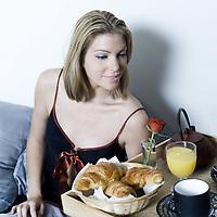 beautiful caucasian women havin her breakfast serve on on tray
