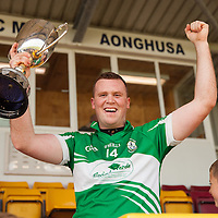 Wolfe Tone's Captain Gary Leahy raising the cup after their Intermediate Football Final Replay win