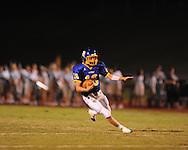 Oxford High's Guy Cameron Billups (16) scrambles vs. Charleston at Bobby Holcomb Field in Oxford, Miss. on Friday, August 27, 2010. Oxford won 24-14 to improve to 2-0.