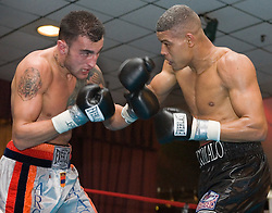 March 10, 2006 - North Bergen, NJ - Giovanni Lorenzo (r) and Archak Ter-Meliksetian (l) trade punches during their 8 round junior middleweight bout.  Lorenzo won the bout when Ter-Meliksetian could not come out for the 8th round.