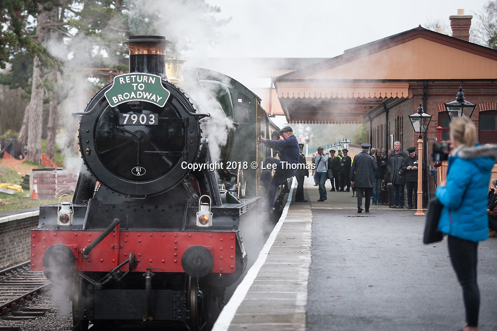 Broadway Station, Broadway, Worcestershire, UK. 30th March 2018.  A steam train carry members of the public departed from Broadway Station in the Cotswolds for the first time in almost 60 years today. On Good Friday, Lord Richard Faulkner of Worcester formally opened the station and traveled on the footplate of Great Western Railway-designed engine no.7903 'Foremarke Hall', the first public train to Cheltenham for 58 years. The new station has been built by GWSR volunteers to a similar design as the 1903 original station. Most of the stations on the former Stratford-upon-Avon to Cheltenham line were closed by British Railways in 1960 and the railway closed completely in 1976, with track and infrastructure removed by 1979. Pictured: A large crowd of steam train enthusiasts and well wishers gathered at the station as the locomotive rolled in. // Lee Thomas, Tel. 07784142973. Email: leepthomas@gmail.com  www.leept.co.uk (0000635435)