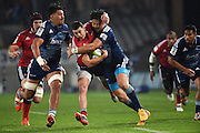Crusaders inside centre David Havili is tackled by Airi Hunt and Ben Lam during the Super Rugby match between The Blues and Crusaders at Eden Park in Auckland, New Zealand. Saturday 6 June 2015. Copyright Photo: Andrew Cornaga / www.Photosport.co.nz