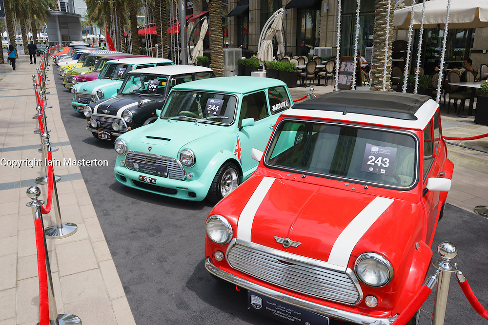 Vintage Mini cars on display at the Emirates Classic Car Festival March 2015 in Downtown district of Dubai United Arab Emirates