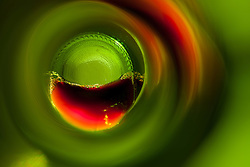 """""""Beauty at the Bottom: Red Wine 6"""" - This is a photograph of a red wine bottle bottle, shot right down inside the mouth of the bottle."""