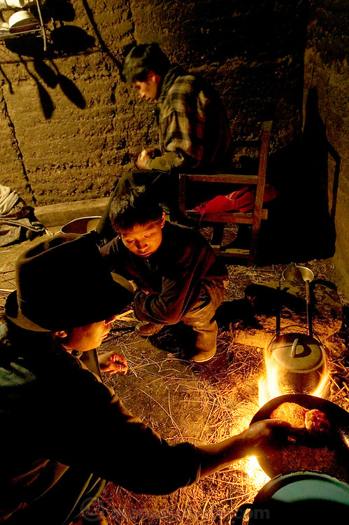 Ermelinda Ayme cooks empanadas for her children in the family's earthen kitchen house in the village of Tingo, central Andes, Ecuador. (From a photographic gallery of kitchen images, in Hungry Planet: What the World Eats, p. 55) Husband Orlando slices onions to help his wife, an unusual task for a village man to undertake in Ecuador. Although the kitchens in these images are wildly different in location and appearance, all of them form the center of a home, even if only temporarily. Kitchens are where families take care of themselves. Cooking is a fundamental task that women, throughout the ages, have undertaken. Ermelinda Ayme is also one of the 80 people featured with one day's food in the book What I Eat: Around the World in 80 Diets.