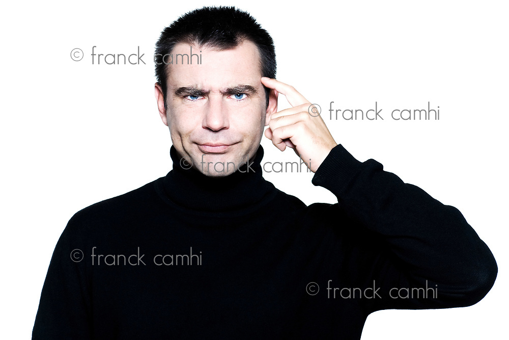 caucasian man portrait expressing sullen stupidity portrait on studio isolated white background