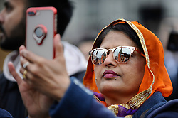 © Licensed to London News Pictures. 28/04/2018. LONDON, UK.  A visitor takes a photo during the festival of Vaisakhi in Trafalgar Square, hosted by the Mayor of London.  For Sikhs and Punjabis, the festival celebrates the spring harvest and commemorates the founding of the Khalsa community over 300 years ago.  Photo credit: Stephen Chung/LNP