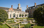 The White Garden and clock tower at Somerleyton Hall country house, near Lowestoft, Suffolk, England, UK