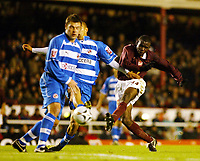 Photo: Chris Ratcliffe.<br />Arsenal v Reading. Carling Cup. 29/11/2005.<br />Fabrice Muamba gets a shot in a Stephen Hunt of Reading cloes him down