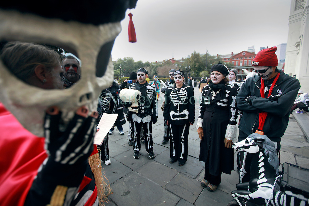 17 Feb 2015. New Orleans, Louisiana.<br /> Mardi Gras Day. Walking with Skeletons. <br /> The Skeleton Krewe arrives in Jackson Square where they recite this year's proclamation and honor members. The Skeleton Krewe meets before dawn beside a cemetery in Uptown New Orleans. They then walk several miles Along Saint Charles Avenue to the French Quarter to celebrate Mardi Gras Day.<br /> Photo; Charlie Varley/varleypix.com